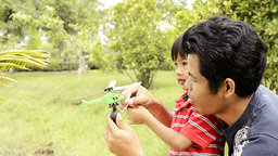 Father and Son Playing With Helicopter Together Footage