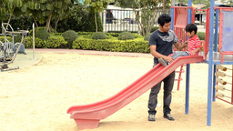 Father and Son Playing on a Slide Footage