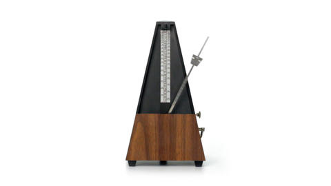 Metronome on white background Stock Video Footage