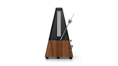 Metronome on white background Stock Video Footage