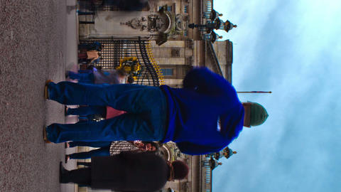 Vertical shot of Tracking time-lapse of tourists at Buckingham Palace in London Footage