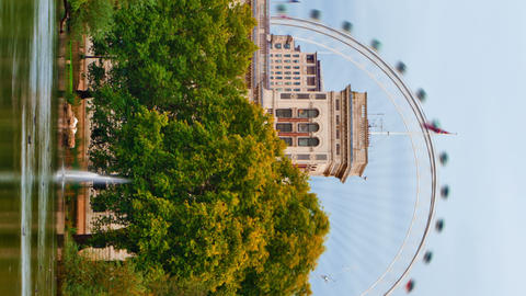 Vertical shot of London Eye time-lapse from Saint James Park in London Footage