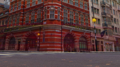 Wide angle time-lapse of an intersection at Saint James Place in London, England Footage