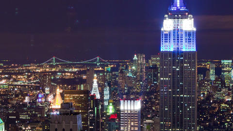 The Empire State Building and New York City night time-lapse. Cropped Footage