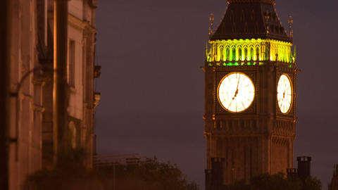 Time-lapse of Big Ben with traffic and people in the foreground. Cropped Footage