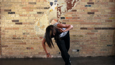 Young woman dancing hip hop filmed in slow motion Footage