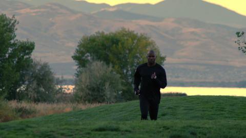 Man jogging towards the camera Footage