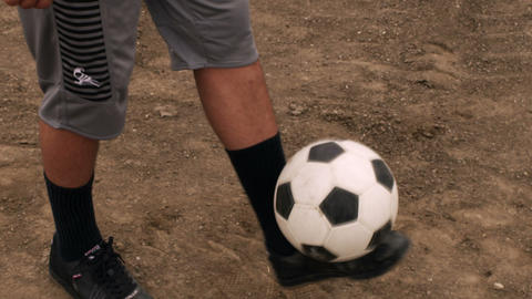 Close up of someone juggling a soccer ball Footage