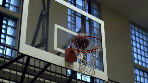 Close up of a basketball going through the net Footage