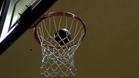 """Slow motion shot of a """"nothing but net"""" basketball shot Footage"""