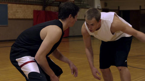 Two young men playing basketball Footage