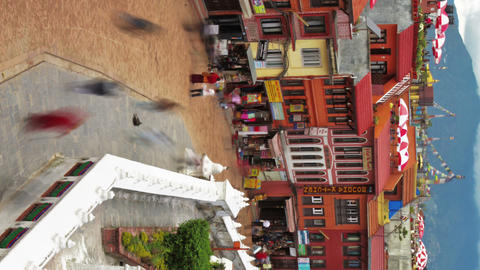 Vertical shot of Time-lapse of people walking around the streets at Boudhanath S Footage