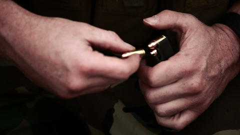 Soldier loading a pistol magazine Footage