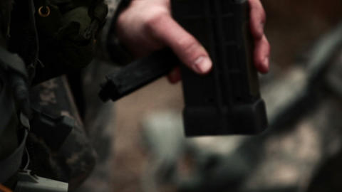 Soldier loading an assault rifle magazine Footage