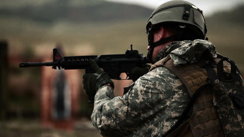Soldier practices switching from rifle to pistol Footage
