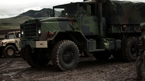 Military convoy truck starting and driving away Footage