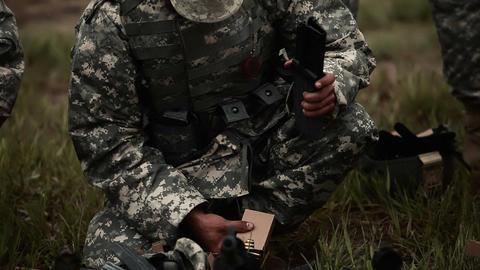 Soldier loads assault rifle magazines Footage