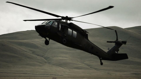 Black hawk helicopter lowering to land Footage