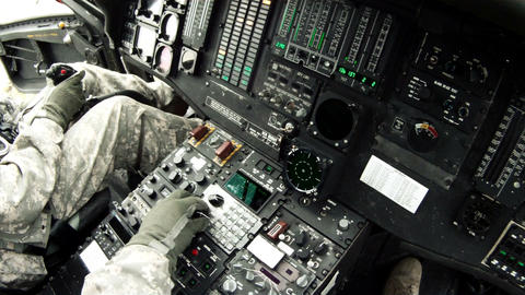 Black Hawk copilot looking at and adjusting instruments Live Action
