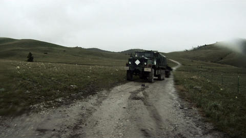 Wide angle shot from the back of a convoy vehicle Footage