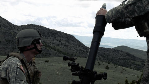 Clip of two soldiers firing mortar Footage