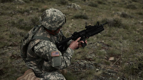 High shot of soldier kneeling and firing 40 mm grenade launcher Footage