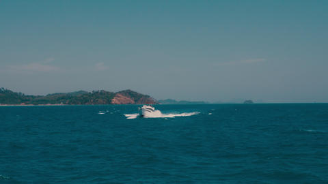 Speedboat sail in the sea. Motorboat floating in a turquoise blue sea water Footage