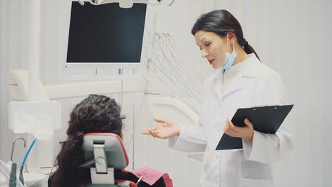 The doctor records the patient's data or the history of the disease. Visit a Footage