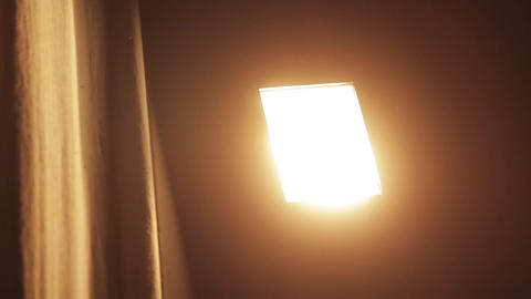 Close-Up Of A Light Bulb In A Cinema Turned On GIF