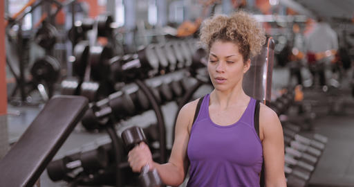 Strong woman working out with dumbbells Footage