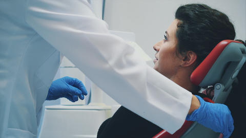 Dentist and patient. Young beautiful dentist repairing... Stock Video Footage