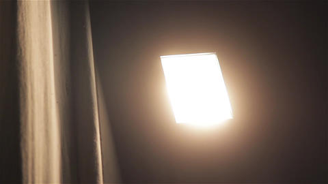 Close-Up Of A Light Bulb In A Cinema Turned Off Footage