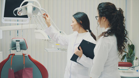 Portrait of a smiling dentist and assistant, looking at... Stock Video Footage