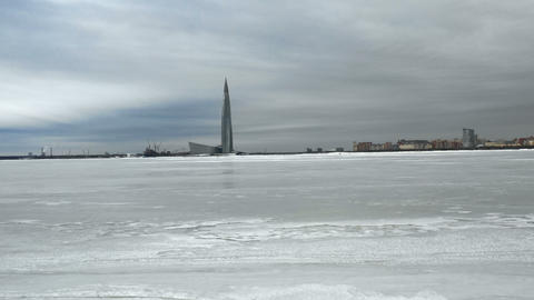 The flight over the ice of Finnish Gulf towards skyscrapper Footage