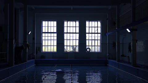 People Swimming In The Indoor Pool. Blue Tone Footage