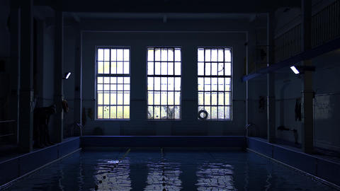 People Swimming In The Indoor Pool. Blue Tone Stock Video Footage