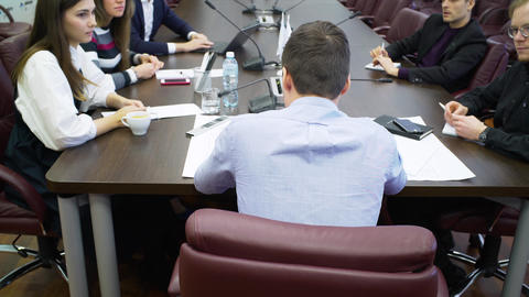 backside view manager holds work meeting with colleagues Footage