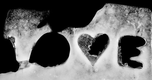 LOVE, word captured in ice melting. alpha matte Stock Video Footage