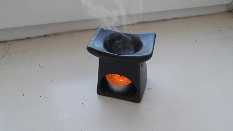 Aromatherapy smells heated shape candle Footage
