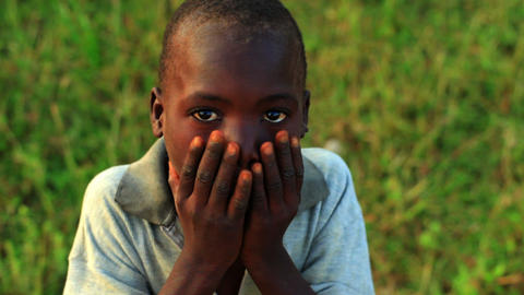 Little Kenyan boy with hands on hips looking at the camera Footage
