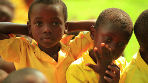 Boys making faces at the camera in Kenya Footage