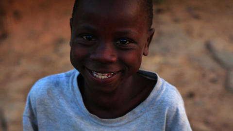 Little Kenyan boy laughing and smiling at the camera Footage
