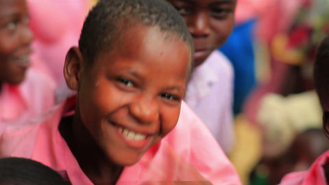 Kids smiling into the camera in Kenya Footage