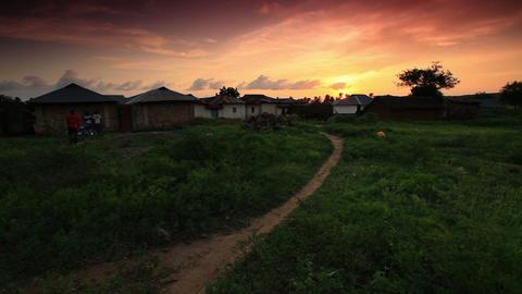 Kenyan huts at sunset Footage