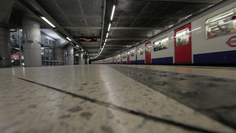 Train drives away in underground train station in London Footage