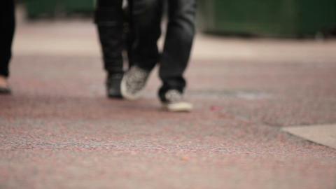 Legs and feet of unidentified people walking in London Footage