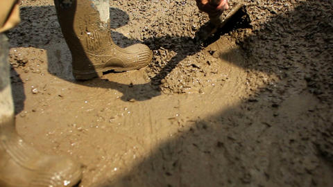Spreading And Moving Muddly Gravel stock footage