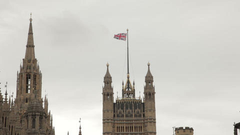 Union Jack flying above Westminster Palace Footage