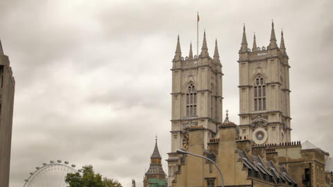 The front towers of Westminster Abbey with the London Eye in the background Footage