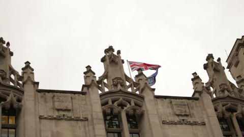 Union Jack flying above an ornate rooftop near Westminster Palace Footage